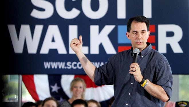 Republican presidential candidate Scott Walker speaks to a room of supporters at Modern Woodman Park in Davenport, Iowa, on Friday, July 17, 2015.