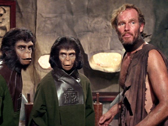 "Charlton Heston is one of the enslaved humans in the world of ""Planet of the Apes."""