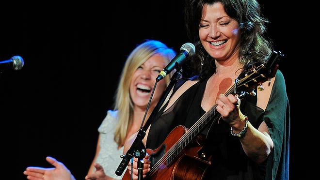 Ellie Holcomb laughs as she sings with Amy Grant at the Gospel Music Association Honors Celebration on Tuesday in Nashville.