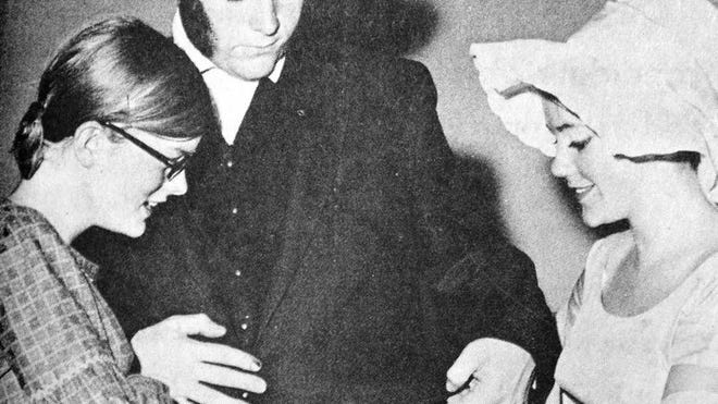 """Carol Nolting (left) and Diana Sundem helped villain Dave Clausen with some last-minute trimming on his costume before the RFHS musical """"Oliver!"""", as seen in this photo that first appeared in the Oct. 29, 1970 edition of the Redwood Gazette."""