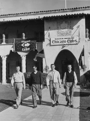 Replaced by present-day city hall, the Maricopa Inn on the northeast corner of Main and Center was the spring training home to the Chicago Cubs. Four players are seen leaving the hotel in 1954 for practice at Rendezvous Park.