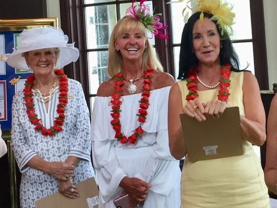 Yacht Club members Sondra Hannafan, Margo Folley and Mary Harris had fun serving as judges for the Best Derby attire contest.