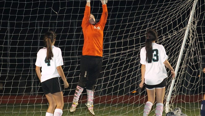 Kathryn Hoar leaps and makes the save during her time at Plymouth South.