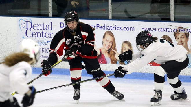 Alyssa Murphy works the puck around a defender. The recent Silver Lake graduate was a three-time Patriot League girls hockey all-star.