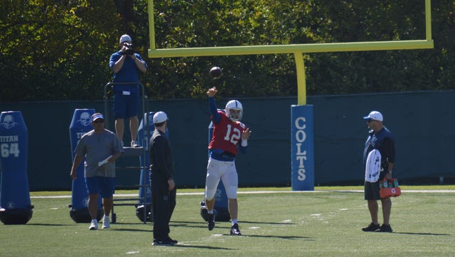 Colts quarterback Andrew Luck throws at practice Wednesday.