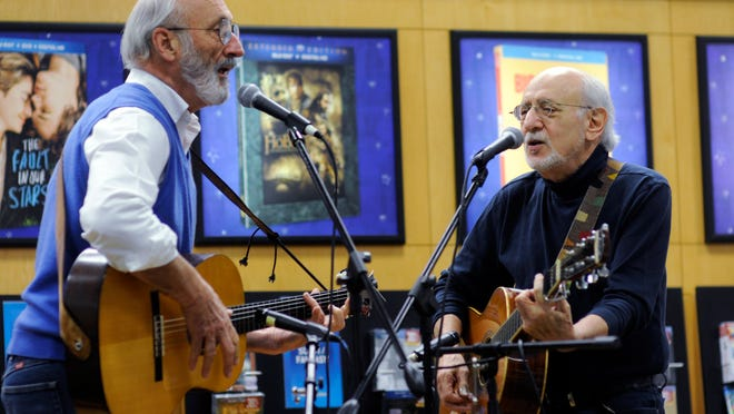 """Noel """"Paul"""" Stookey, left, and Peter Yarrow perform """"Leaving on a Jet Plane"""" among other songs before their book-signing event on Thursday at the Barnes & Noble in Kingston. The duo signed copies of their book, """"Peter, Paul and Mary: 50 Years in Music and Life."""" They also performed Pete Seeger's """"Where Have all the Flowers Gone"""" at the event."""