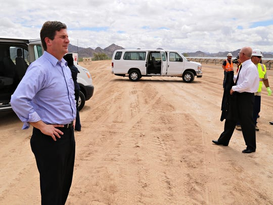 Phoenix Mayor Greg Stanton surveys the site of the Desert Star Solar Plant in Buckeye. The plant has 50,400 panels and will be able to generate enough energy to power 2,500 home at once.
