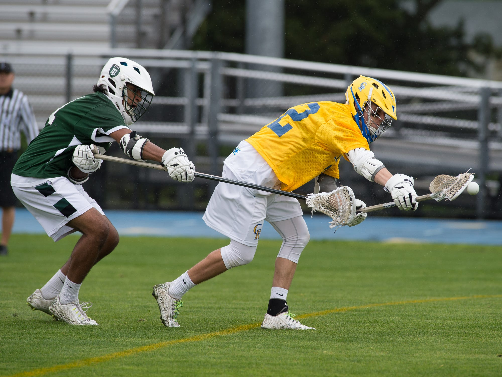 Tower Hill's Tej Vaddi (31), left tries to steal the ball from Caesar Rodney's Jacob Pangle (22).