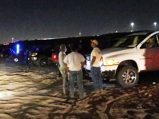 Off-road enthusiasts gather in a desert area just east of the Socorro Student Activities Complex in far East El Paso Wednesday night.