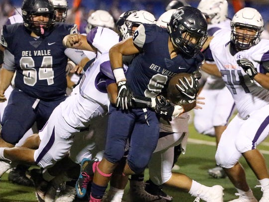 Del Valle running back Adrian Vazquez, 9, charges forward
