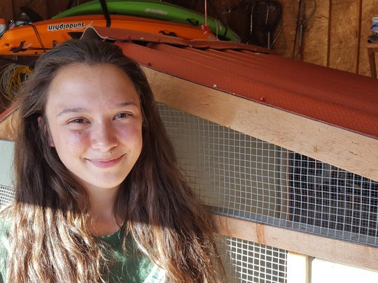 Sabrina Radtke, 14, poses for a photo at her Weston home by her family's unused chicken coop on June 5, 2017. In May she presented to the Weston Village Board on why chickens should be allowed in village backyards.