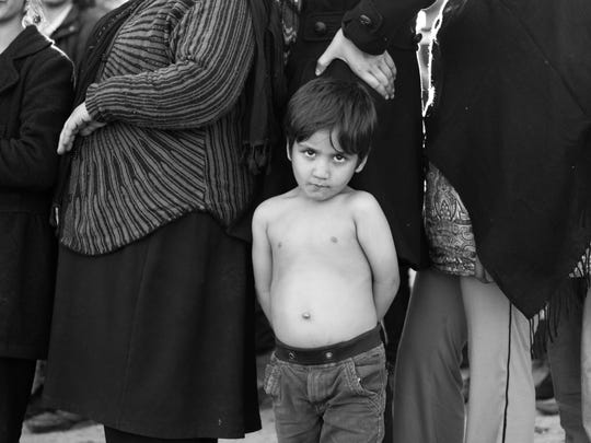 An Afghan family at the Moria refugee camp in Lesvos,