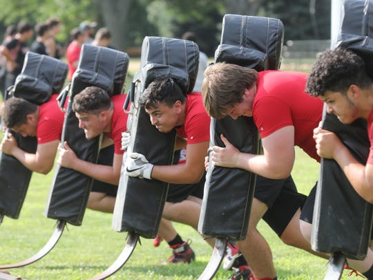 Ridgefield Park linemen push the blocking sled as part of the Lineman's Challenge at the South Bergen 7 on 7 Shootout and Lineman event in East Rutherford.