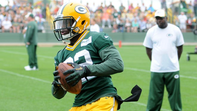Green Bay Packers safety Chris Banjo catches the ball during drills at training camp practice at Ray Nitschke Field, Thursday, August 21, 2014.