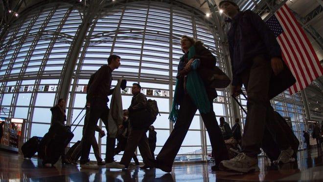 Airline travelers Nov. 26 at Ronald Reagan National Airport in Arlington, Va.