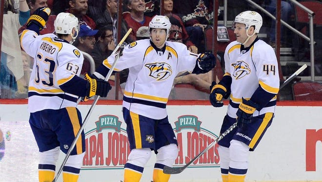 Predators left wing James Neal, center, and teammates celebrate the game-winning goal in overtime against the Arizona Coyotes.