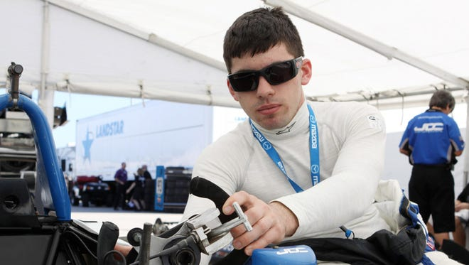 """Michael Johnson from Mt. Morris in September 2012 received the """"USF2000 Spirit Award"""" as the driver who best displayed """"the heart of a champion"""" in the developmental open-wheel series that supports IndyCar and Indy Lights. He is pictured working on his car in 2012."""