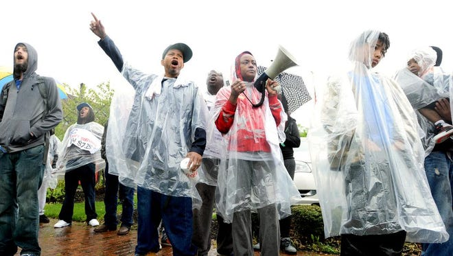 Bobby Greenwood, center left, and Sherricka Williams, center right, lead the chants of the crowd during a protest along Hendersonville Road for higher wages for fast food workers and other minimum wage employees on Wednesday.