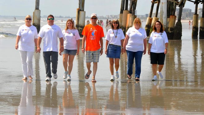 The Cocoa Beach Kidney Walk is set for May 9 at Cocoa Beach Pier. Walking are Dee Hill, left, Mike Futch,  Dawn Futch, organizer Bill Hahn, Mary Carpenter, Julie Newhouse and Pat Brown.
