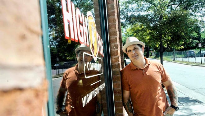 Jay Weatherly stands at the Broadway Street location of his coffee bar, High Five, on Monday. Weatherly hopes to open a second location on Rankin Avenue in the coming weeks.