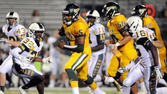 Reynolds High School's Rico Dowdle breaks free for a 50-yard touchdown run in the third quarter against West Forsyth Friday at Reynolds High School.