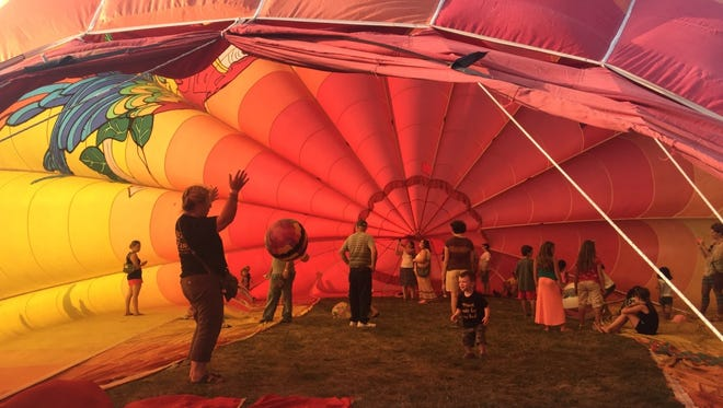 Children experience the inside of a hot air balloon at the 34th annual New York State Festival of Balloons in Dansville.