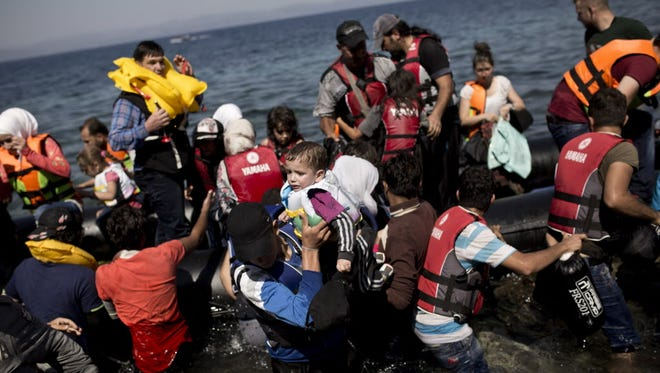 Syrian refugees arrive on the shores of the Greek island of Lesbos on Sept. 11, 2015.