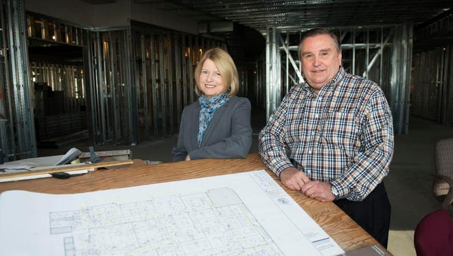 The Collider Executive Director Marilyn McDonald, left, joins CEO Bill Dean in the proposed lobby area of The Collider on the fourth floor at 1 Haywood St., in downtown Asheville.