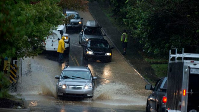 City crews respond to heavy flooding on Beverly Road in East Asheville during heavy rain Tuesday afternoon. The rain caused flooding in many areas around the area.