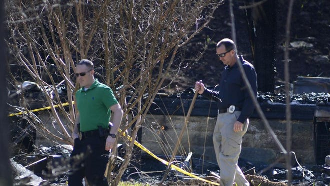 Investigators, acting on search warrants, began digging for clues March 31 on the Owens Cove Road property of murder suspect Robert Jason Owens.