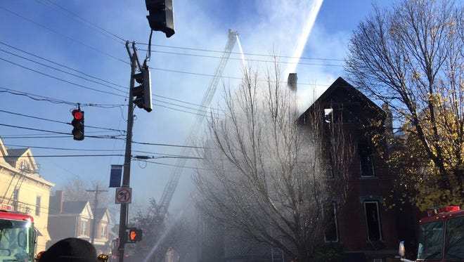 Firefighters work a 2-alarm fire on Scott St. in Covington Wednesday morning.