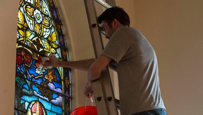 Kevin Flannery, from Emil Frei and Assoc., works on restoring the stained glass windows in the Basilica of St. Michael the Archangel in downtown Pensacola. The St. Louis based company originally made and installed the windows, is working on the restorations. The project is scheduled to be complete by early spring.