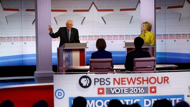 Bernie Sanders and Hillary Clinton debate Feb. 11, 2016, in Milwaukee.