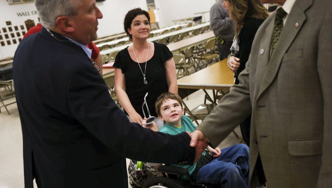 Jackson Salemme, 9, in wheelchair, looks at Sen. Mike Folmer, R-Lebanon County, at a 2014 medical marijuana town hall meeting in Adams County. The Pennsylvania House passed medical marijuana legislation, bringing the bill one step closer to final passage.