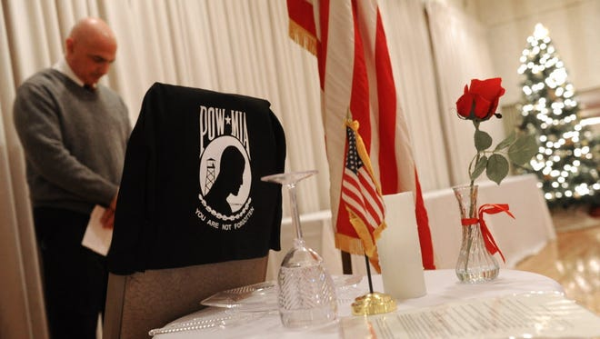Phil Palandro, director of York County Veterans Affairs, bows his head in respect during the POW/MIA presentation of the Pearl Harbor/Battle of the Bulge remembrance ceremony in the White Rose Room at the York Expo Center in 2013. He plans to retire June 1.