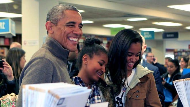 President Obama and daughters Sasha, center, and Malia in Washington in 2014.