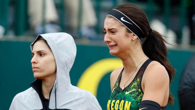 Oregon's Hannah Cunliffe walks off the track after a women's 100-meter semifinal at the NCAA outdoor track and field championships in Eugene, Ore., Thursday, June 9, 2016. (AP Photo/Ryan Kang)