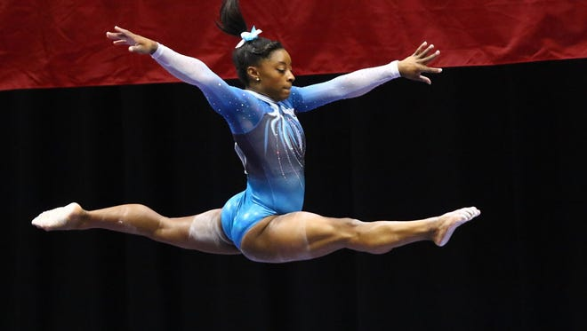 Simone Biles competes on the balance beam during Day 2 of the P&G Gymnastics Championships in St. Louis on Sunday.