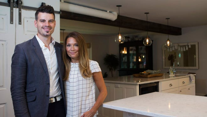 After a complete renovation, AJ (left) and Jamie Fink's 1968 home in Brookfield now features modern stylings.