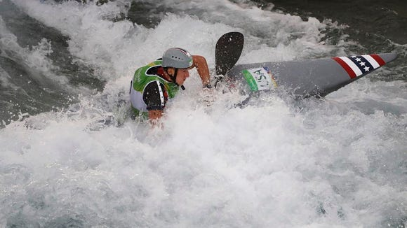 USA's Michal Smolen competes during the men's single kayak heats of the whitewater slalom at the 2016 Summer Olympics in Rio de Janeiro, Brazil, Sunday.