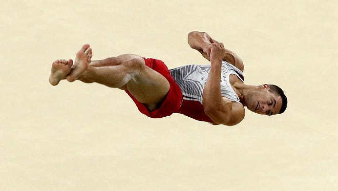 Jake Dalton competes in the Men's Floor Exercise on Sunday.