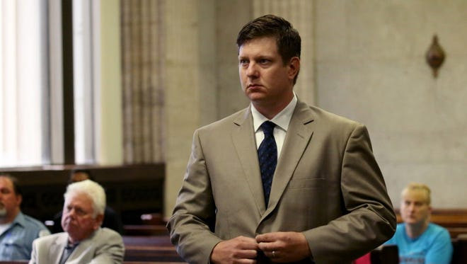 Jason Van Dyke approaches the bench during a hearing at Leighton Criminal Courts Building in Chicago on Aug. 18, 2016. Van Dyke is the Chicago police officer charged with murder in the 2014 videotaped shooting death of black teenager Laquan McDonald.