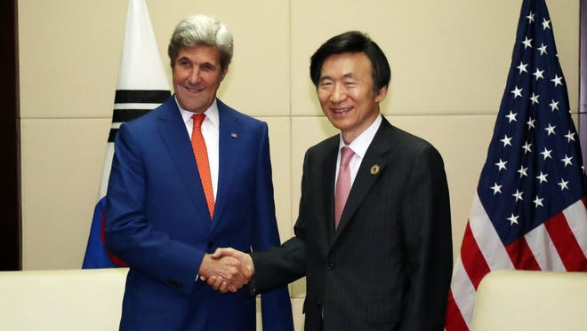 South Korean Foreign Minister Yun Byung-se shaking hands with US Secretary of State John Kerry before a meeting at in Vientiane, Laos on July 25, 2016.