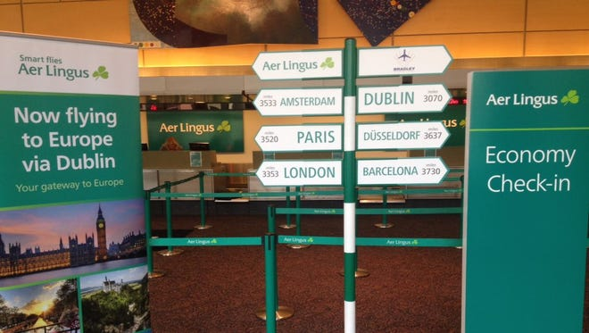 Signs at Hartford's Bradley International Airport broadcast the arrival of new Aer Lingus service to Dublin.