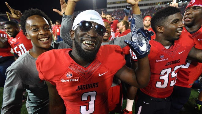 South Alabama safety Diantae Thomas (3) and running back Deonta Moore (35) celebrate after defeating San Diego State.