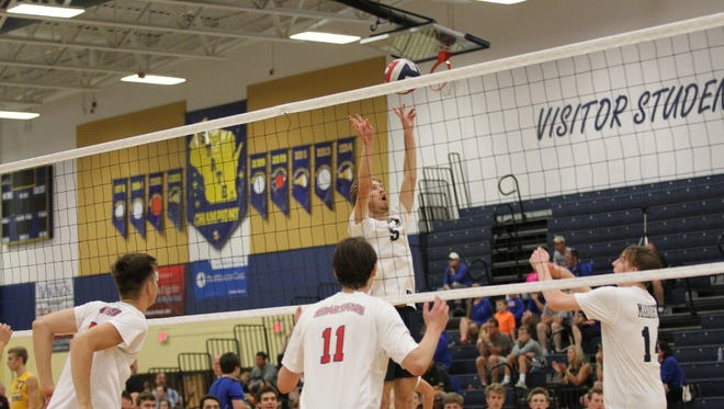 Conor Ward, the setter for Marquette's top-ranked volleyball team, sets up a teammate.