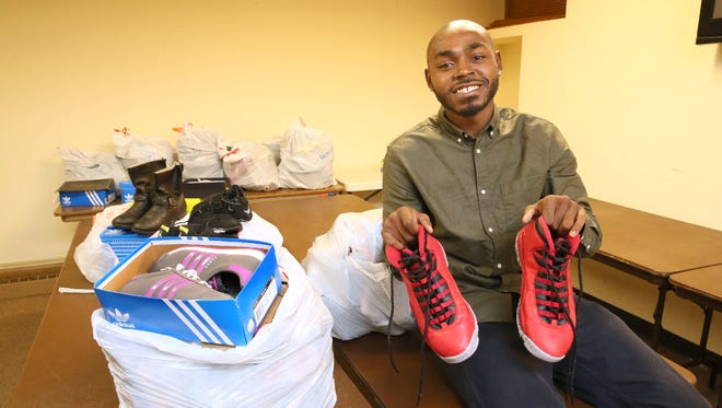 UW-Milwaukee graduate student Jacarrie Carr has founded his own nonprofit, Jacarrie's Kicks for Kids. He collects new and gently used shoes and distributes them to kids in need.