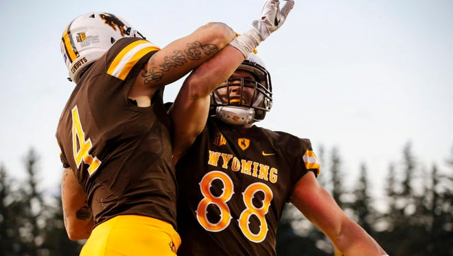 Wyoming tight end Jacob Hollister (88) celebrates his touchdown against Boise State.