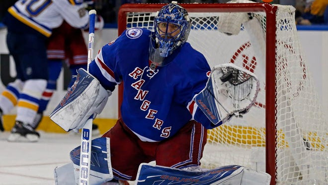 Rangers goalie Henrik Lundqvist (30) makes a save during the third period against the Blues.