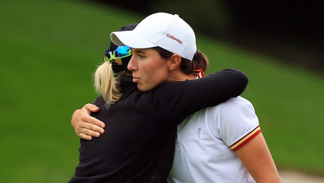 Sarah Jane Smith of and Carlota Ciganda embrace after they finish their round.